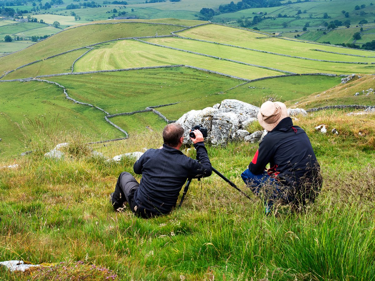 Photographing meadows in Malhamdale from the top viewpoint